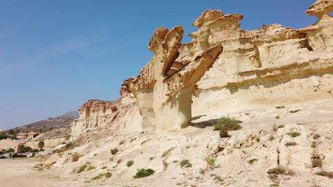 Yellow space rock in the desert. Big yellow futuristic mountains Live Action