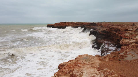 Sparkling ocean waves with rock, waves splashing against coastal rock, waves Live Action