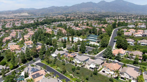 Aerial view of recreational facilities with pools in private residential Live Action