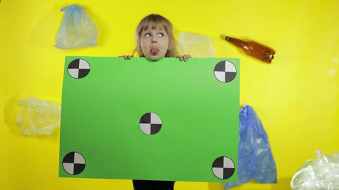 Girl activist holding chroma key poster with tracking points. Environment trash Live Action