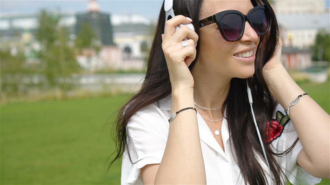 Happy young urban woman enjoy music outdoors Live Action