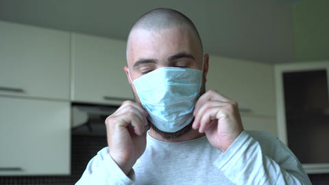 Bald Man Panic Wearing a Virus Protection Mask. Pandemic, Disease. Serious and Live Action