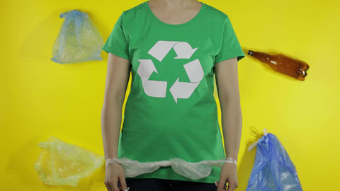 Unrecognizable woman free up from cellophane package. Save ecology. Plastic Live Action