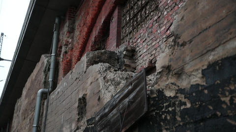 Red brick wall as texture background. High flat wall of an old building Live Action