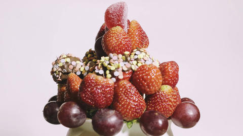 Close-up of delicious fruit bouquet spinning on a white background Footage