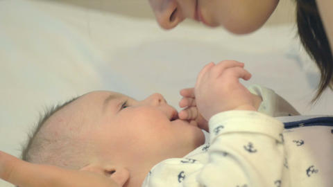 Young mother caressing her newborn boy Footage