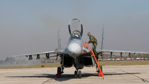 Combat Jet of Serbian Air Force with Open canopy and a specialist on the ladder Live Action