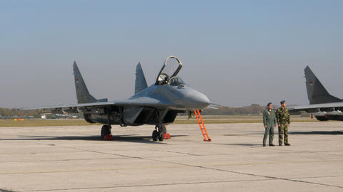 Military Fighter Jet Pilot and Specialist in front of a Serbian MiG29 Fulcrum Live Action