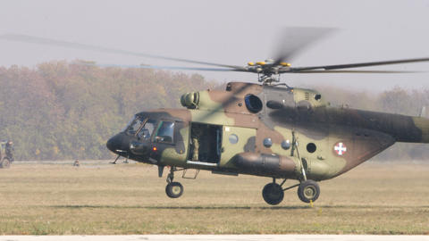 Russian Military Transport Helicopter Mil Mi-17 of Serbia Lands on Battlefield Live Action