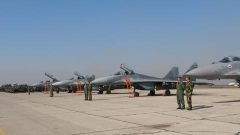Tilt View of Combat Fighter Jet Pilots and Specialists in front of MiG29 Fulcrum Live Action