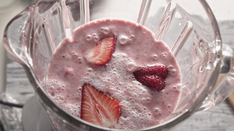 Preparation of a milkshake, smoothies from strawberries, cream, chia seeds. Turn Live Action
