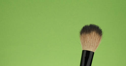 Horizontal movement of the brush for makeup on a green background Live Action