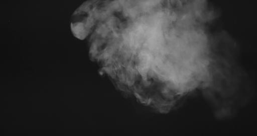 Video of moving white smoke or vapor on a black background Live Action