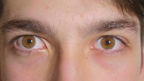 Close-up of man eyes opening scared Live Action