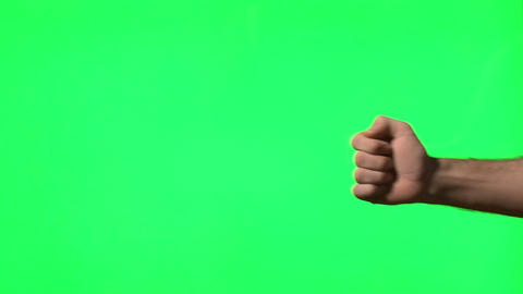 Male hand gestures on green screen: presenting, pointing, thumbs up, snapping, c Footage