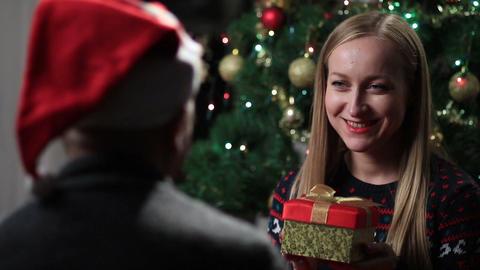 Man giving a christmas present to his girlfriend Footage