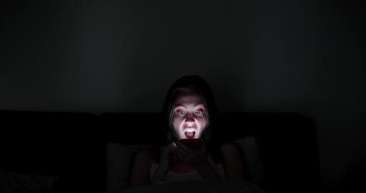 Screaming spooky woman in darkness Live Action