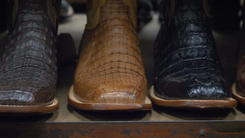 Stylish cowboys boots on a shelf in a store Live Action