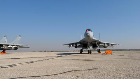 Russia Warfare. Military High Speed Jet MiG-29 Parked Armed ready for War Live Action