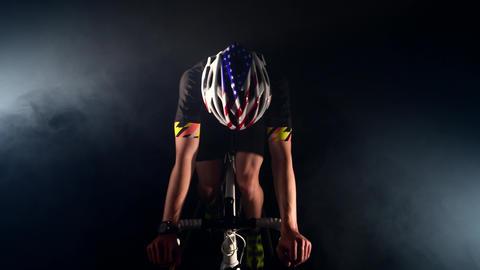 adult sportsman cycling road bike, Pedaling, sport concept, studio black Live Action