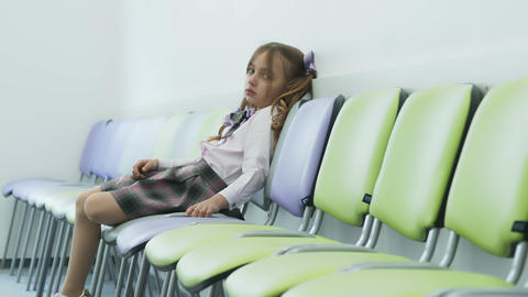 sad little girl sitting alone in a chair and sad. Depression in young children Live Action