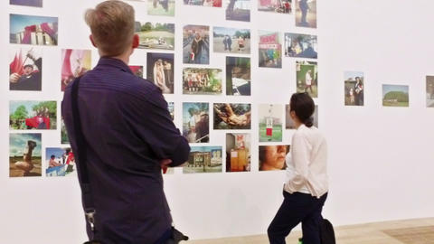 People visiting a photography exposition the Tate Modern Gallery, London. Slow m Footage