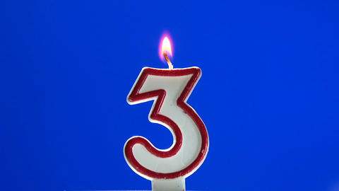 Number 3 - three birthday candle burning - blow out at the end Footage