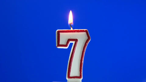 Number 7 - seven birthday candle burning - blow out at the end Footage
