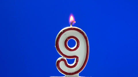 Number 9 - nine birthday candle burning - blow out at the end Footage