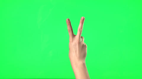 Female hand gestures on green screen: clapping, thumbs up, pointing, countdown f Footage