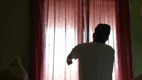 Teenager waking up and opening drapes Footage