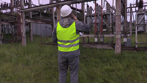 Electricians in electrical substation Live Action