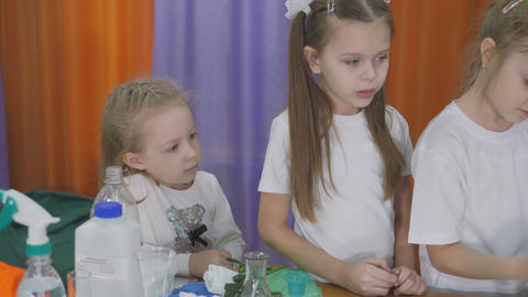 Chemical experiments for children. Children wear protective equipment before Live Action