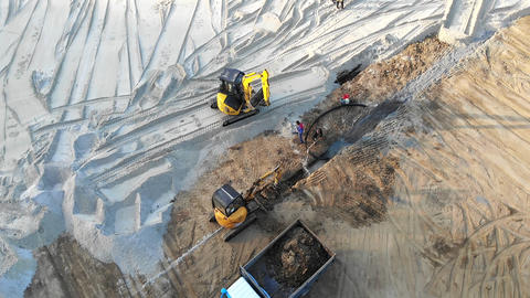 Aerial view Machinery on a construction site. Construction work with the help of Live Action