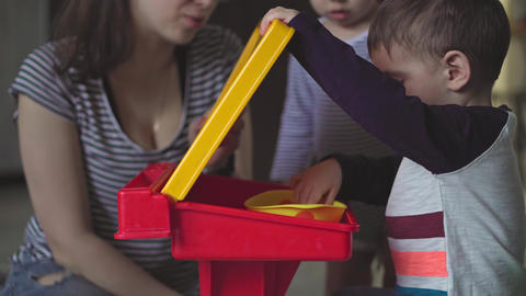 Motherhood, childhood, feeding, food, family, care concept - middle plan dark Live Action