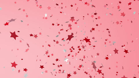 Red and white, shiny stars of confetti fly from left to right Live Action