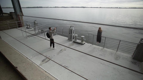Mobile photo concept. Photo session of male photographer taking pictures of Live Action