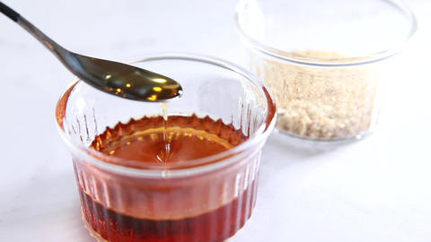Drizzle with sesame oil. Edible and beauty oils Live Action
