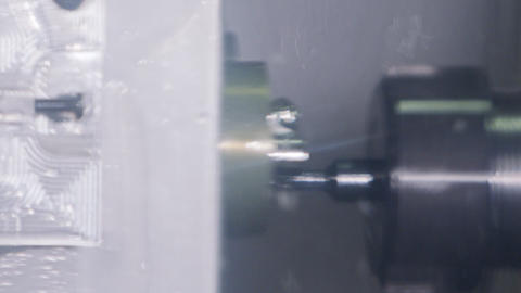 Slow motion of processing precision metal parts with a milling machine and lathe Live Action