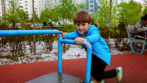 A little boy playing on the outdoors playground Live Action