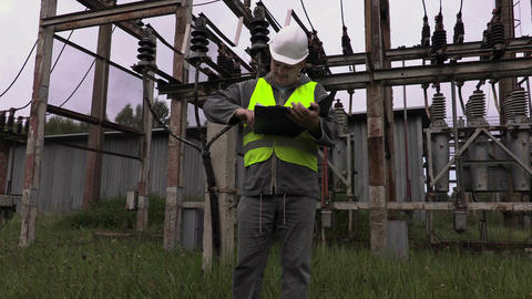 Electrician engineer checkout documentation at substation Live Action