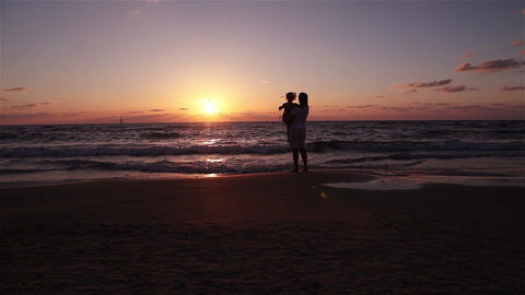 Mother and daughter go to the sea and watching the sunset Footage