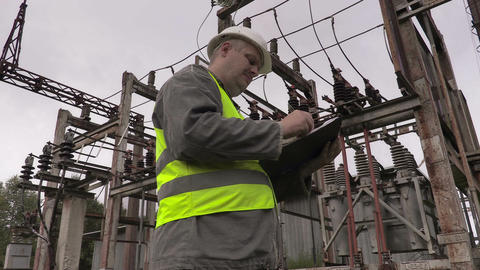 Electrician writing in electrical substation Footage