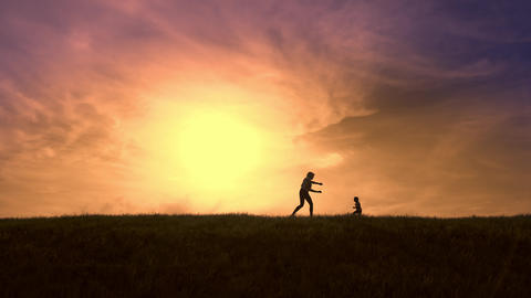 Silhouettes of mother and daughter fun run after each other at sunset Live Action