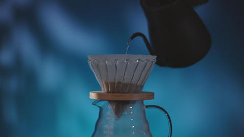 Coffee Drip Concept. Pouring Hot Water from Kettle into a Dripper. Making Hot Coffee Drink in House. Live Action