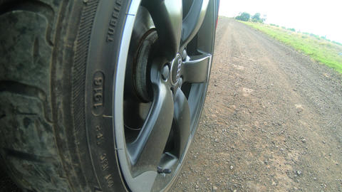 Car wheel spinning Point of View, day country side Live Action