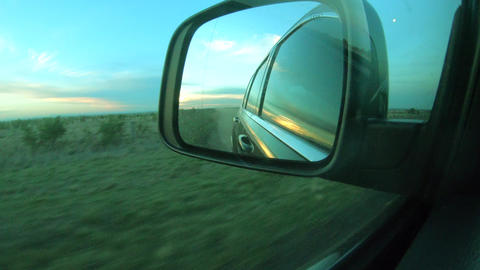 Driving Rural Road View of Side Mirror in evening time. Driver`s point of view viewpoint looking Live Action