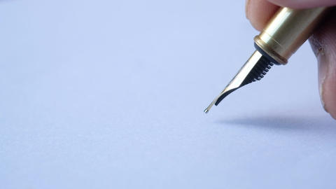Fountain pen in the hand on the white paper Live Action