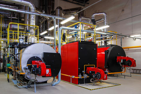 Gas boilers in gas boiler room for steam production フォト