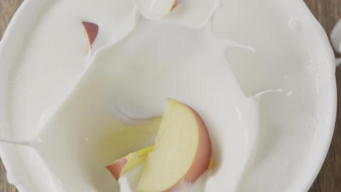 Video of falling fresh ripe natural nectarine fruits into a bowl with natural Live Action